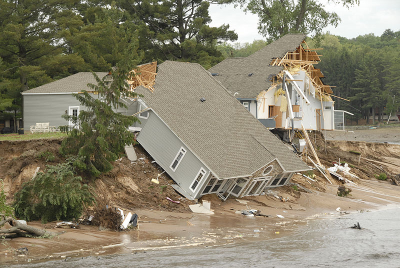 A house collapsed after the 2008 Wisconsin Floods. Photo credit: US Air Force via the Great Lakes Echo.